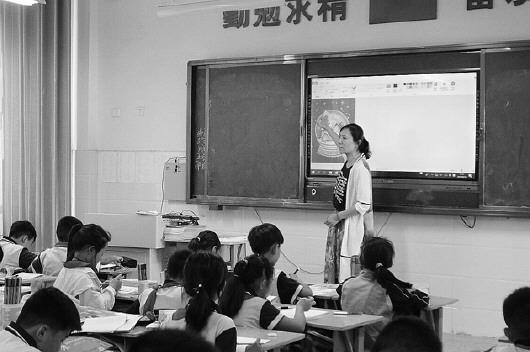 一墙之隔的光明路街道中心小学和枣庄市第四十二中学,学校管理和教